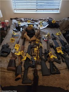 PICTURED: Arsenal of weapons found during raid of 'zip tie guy's' home – as prosecutors reveal he had 'stashed guns outside Capitol building before entering'
